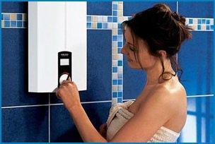 Девушка регулирует температуру воды в бойлере